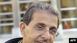 Ông Mohammed Wali Zazi rời tòa án liên bang New York, 22/7/2011