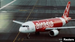 FILE - An AirAsia plane is seen on a runway at Kuala Lumpur International Airport, August 2014.