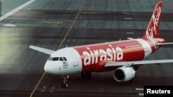 FILE - An AirAsia plane is seen on a runway at Kuala Lumpur International Airport in this August, 2014 image.