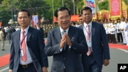 FILE: Cambodian Prime Minister Hun Sen, center, greets his government officers during the country's 66th Independence Day from France, at the Independence Monument in Phnom Penh, Cambodia, Saturday, Nov. 9, 2019. (AP)