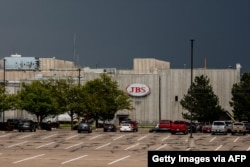 FILE - A JBS Processing Plant stands dormant after halting operations on June 1, 2021 in Greeley, Colorado. JBS facilities around the globe were impacted by a ransomware attack, forcing many of their facilities to shut down.