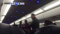 VOA60 America - Three men and a woman of apparent Middle Eastern descent removed from a Chicago-bound flight