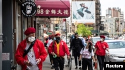 Wally Ng, a member of the Guardian Angels, patrols with other members in Chinatown during the outbreak of the coronavirus disease (COVID-19) in New York City, New York, U.S., May 16, 2020.