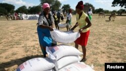 FILE: Villagers queue to collect their monthly food aid ration of cereals at a school in drought-hit Masvingo, Zimbabwe, June 2, 2016.