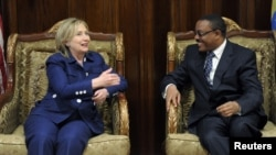 U.S.Secretary of State Hillary Clinton talks with Ethiopia's Deputy Prime Minister