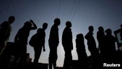 """Des migrants éthiopiens et érythréens à la """"jungle"""" de Calais, France, 23 août 2017."""