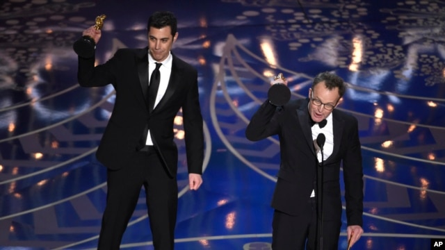 "Josh Singer, left, and Tom McCarthy accept the award for best original screenplay for ""Spotlight"" at the Oscars on Feb. 28, 2016, at the Dolby Theatre in Los Angeles."