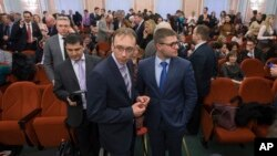 Jehovah's Witnesses wait for the decision in a courtroom in Moscow, Russia.