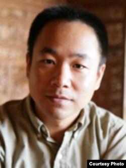 美国明尼苏达大学公共事务学院副教授赵志荣