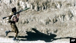 FILE - A fighter armed with a Soviet-made RPG-7 rocket launcher runs toward his position in Northern Afghanistan, Oct. 14, 2001. A U.S. company is selling a redesigned and updated version of the Soviet RPG-7 anti-tank weapon to Ukraine.