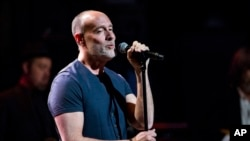 FILE - Marc Cohn performs at Love Rocks NYC! in New York. After winning a Grammy in 1991, singer-songwriter Mark Cohn charted his own course, a long winding road which led him to songs that have been Grammy nominated for two years in a row, March 9, 2017.