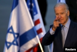 U.S. Vice President Joe Biden gestures after disembarking from a plane upon landing at Ben Gurion International Airport in Lod, near Tel Aviv, Israel, March 8, 2016.