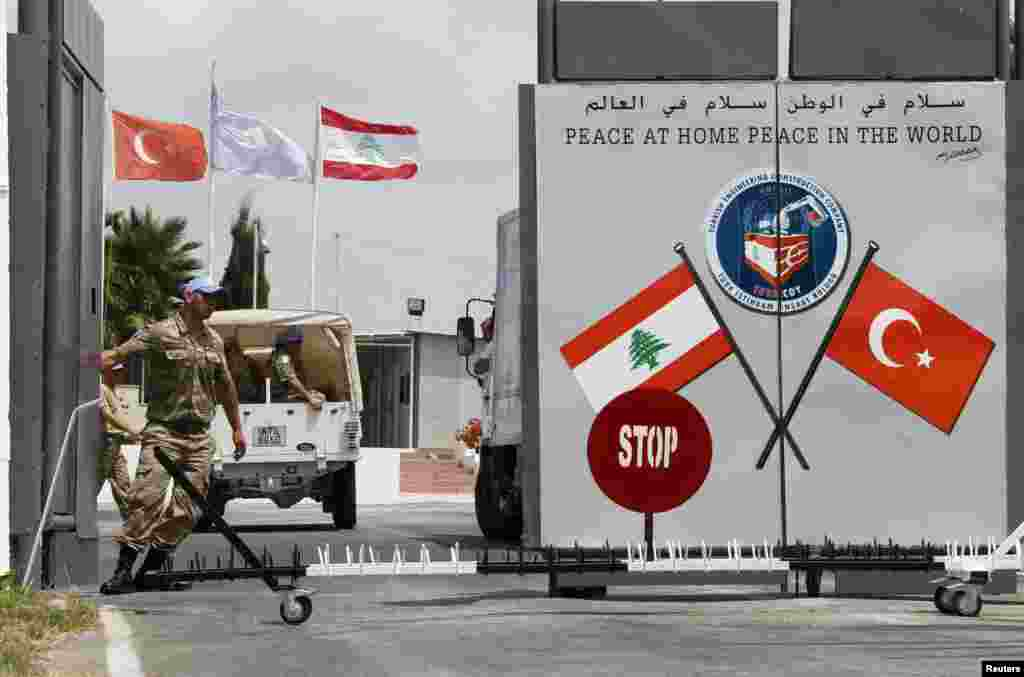 A Turkish peacekeeper of the United Nations Interim Force in Lebanon (UNIFIL) closes a gate of the Turkish Engineering Construction Company (TURKCOY) of UNIFIL in the village of Shaaytiyeh, southern Lebanon.