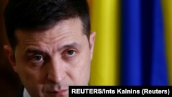 Ukraine's President Volodymyr Zelenskiy attends a news conference in Tallinn, Estonia November 26, 2019