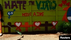 FILE - An AIDS mural is seen outside a clinic at Kumba Iron Ore, the world's largest iron ore mines in Khathu, Northern Cape Province, South Africa, Nov. 15, 2011.