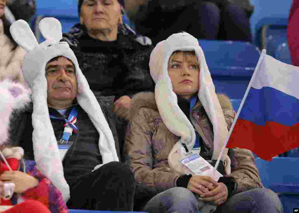 Spectators wait for the start of the figure skating competition at the Iceberg Skating Palace, in Sochi, Russia, Feb. 16, 2014.