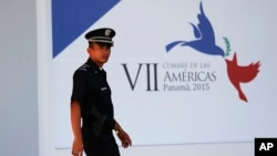 A policeman walks outside of the Atlapa Convention Center, site of the VII Summit of the Americas in Panama City, Panama, April 8, 2015.