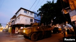 Brazilian Marine's armored vehicles patrol the Mare slums complex in Rio de Janeiro, March 30, 2014.