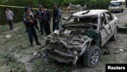지난 11일, 아프간 수도 카불에서 일어난 자살 폭탄테러 현장을 조사하는 아프간 경찰.