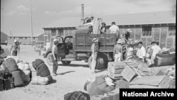 Belongings of Japanese-American internees newly arrived at the Minidoka camp from western Washington state await delivery to their barracks in August 1942 (Francis Stewart, War Relocation Authority via National Archives). Hawaii Attorney General Douglas Chin likens the Tump administration's travel ban to the World War II-era wholesale internment of Japanese Americans, German Americans and Italian Americans because of national security concerns.