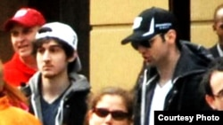 Photos of the two suspects near the finish line of Boston Marathon. (Courtesy Bob Leonard)