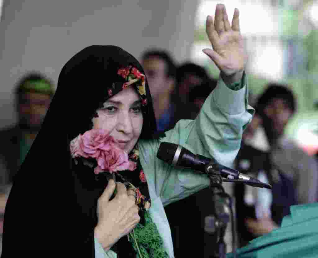 FILE - In this Tuesday, June 9, 2009 file photo, Zahra Rahnavard, the wife of reformist candidate Mir Hossein Mousavi, waves to the people during a rally at Heidarnia stadium, during the final days of the election race in Tehran, Iran. In a part of the Mu