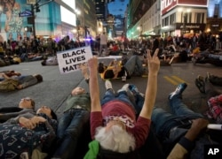 Protestors lay in the street to stage a die-in at Herald Square, Wednesday, April 29, 2015, in New York. Several hundred people gathered in New York to protest the death of Freddie Gray in Baltimore..