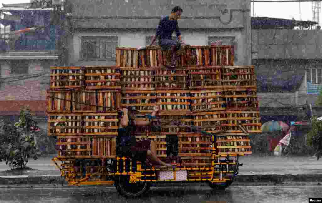 Vendors ride on a vehicle transporting crates containing bananas in Malabon, Metro Manila, Philippines.