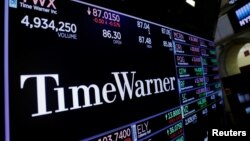 FILE - Time Warner shares are projected on a acreen above the floor of the New York Stock Exchange, New York.