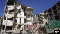 """""""Белые каски"""" на улицах Идлиба после удара сирийских ВВС. 12 июля 2019."""