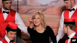 Entertainer Bette Midler, center, gestures as she poses with dancers during a news conference at the Caesars Palace in Las Vegas, May 3, 2007.