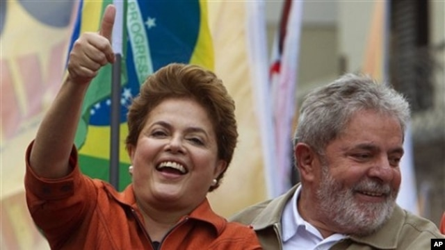 Brazil's President Luiz Inacio Lula da Silva, right, smiles as Workers Party presidential candidate Dilma Rousseff gestures to supporters during a campaign rally in Sao Bernardo do Campo, outskirts of Sao Paulo, Brazil, Saturday, Oct. 2, 2010. Brazil will