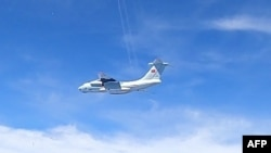 This handout photo from the Royal Malaysian Air Force taken on May 31, 2021 and released on June 1 shows a Chinese People's Liberation Army Air Force (PLAAF) Ilyushin Il-76 aircraft that Malaysian authorities said was in the airspace over Malaysia's marit