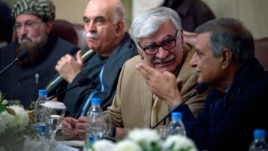 Asfandyar Wali Khan, second right, head of the Awami National Party, presides over a major conference with various political parties and religious group representatives in Islamabad, Feb. 14, 2013.