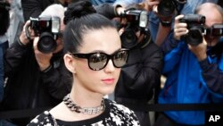 FILE - Katy Perry arrives at the presentation of Chanel's ready-to-wear Spring/Summer 2014 fashion collection in Paris, Oct. 1, 2013.