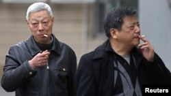 Smokers in a street in Shanghai, China, March 22, 2012.