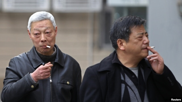 FILE - Smokers in a street in Shanghai, China.