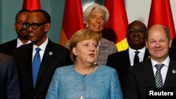 German Chancellor Angela Merkel, center, German Finance Minister Olaf Scholz, right, International Monetary Fund (IMF) Managing Director Christine Lagarde and heads of states of African countries pose for a family photo ahead of the 'G20 Compact with Africa' summit at t