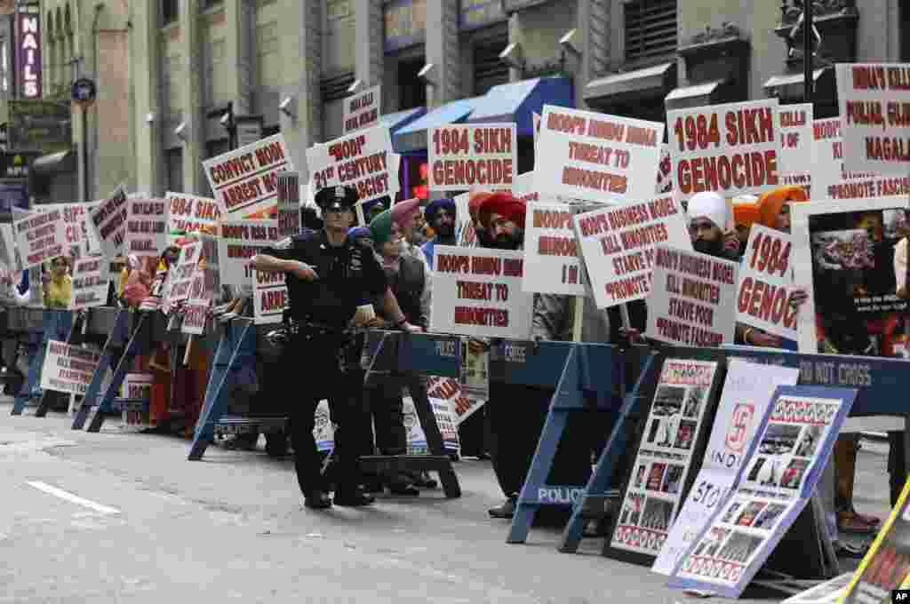 Protestors stage a demonstration against Indian Prime Minister Narendra Modi across the street from Madison Square Garden, where Modi spoke to a capacity crowd from the Indian-American community, Sunday, Sept. 28, 2014, in New York. A day after addressing