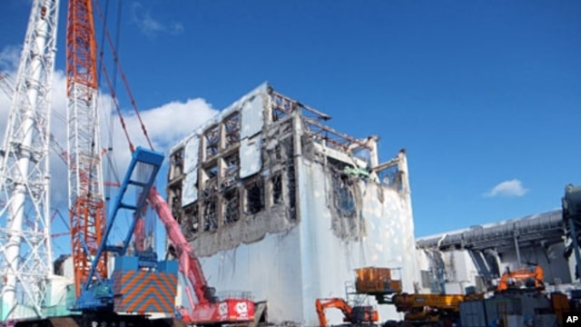 The crippled Fukushima Daiichi nuclear power plant's No.4 reactor building is seen after the removal of debris on the upper side of the unit in Fukushima prefecture, January 5, 2012