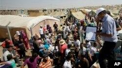 Suasana di salah satu kamp pengungsi di Dahuk, 430 kilometer sebelah barat laut Baghdad, Iran (13/8).