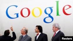 Belgium King Albert II (2nd L) visits the site of Google Datacenter in Mons, June 16, 2009.