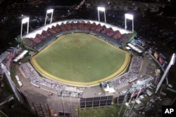 Baseball stadiums can hold thousands of fans for day or night games. (AP Photo)