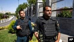 FILE - Police patrol outside Iran's parliament building, in Tehran, Iran, June 7, 2017.