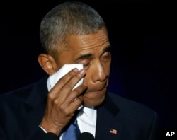 President Barack Obama wipes his tears as he speaks at McCormick Place in Chicago, giving his presidential farewell address, Jan. 10, 2017.