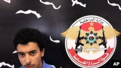 In this Wednesday, May 24, 2017 photo, Hashim Ramadan Abedi appears inside the Tripoli-based Special Deterrent anti-terrorism force unit after his arrest on Tuesday for alleged links to the Islamic State extremist group. Abedi is the brother of Salman Abedi, the Manchester suicide bomber suspected.