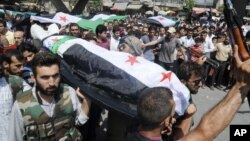 People carry a body of a person killed in clashes in Aleppo, Syria, Friday, July 27, 2012.