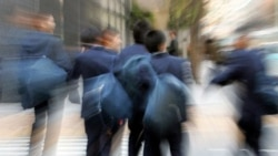 Boys leaving a school in Tokyo in a 2007 photo