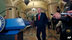 Senate Majority Leader Mitch McConnell of Kentucky, walks to the podium to speak to the media, on Capitol Hill, Sept. 19, 2017, in Washington.