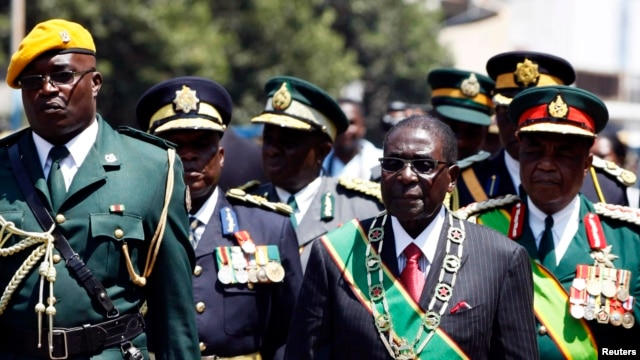 Zimbabwe's President Robert Mugabe arrives for the opening of parliament in Harare, Sept. 17, 2013.